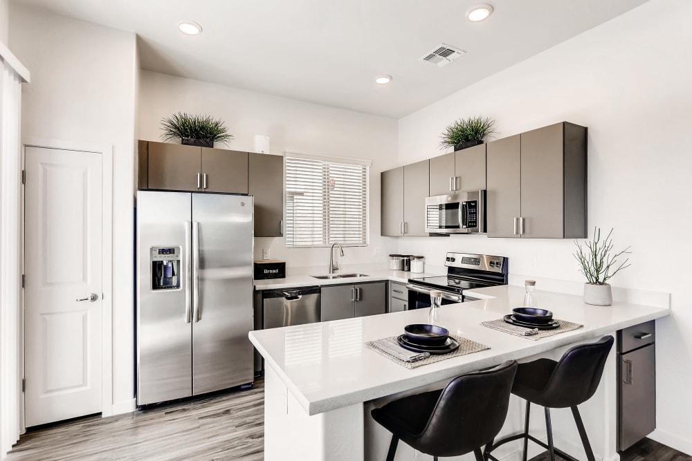 Kitchen with breakfast bar at Avilla Camelback Ranch in Phoenix AZ