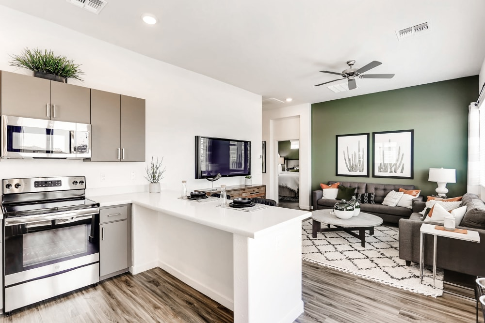 Large living room with open view to kitchen at Avilla Camelback Ranch in Phoenix AZ