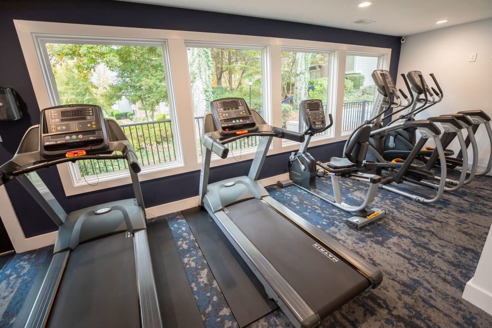 A fitness center with a large window at The Corners at Crystal Lake in Winston Salem, North Carolina