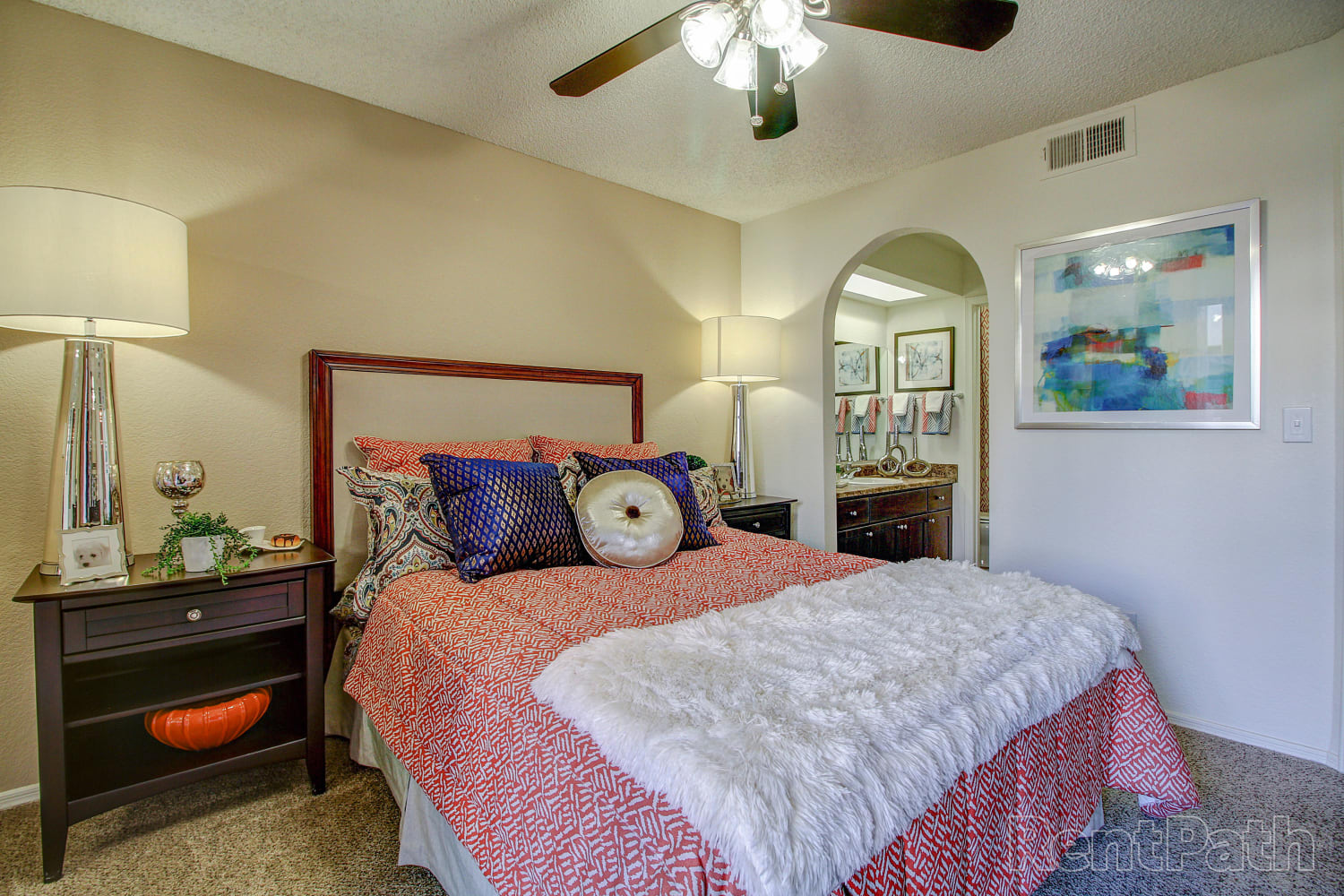 Bedroom with a ceiling fan at Casa Santa Fe Apartments in Scottsdale, Arizona