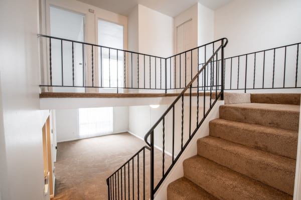 Interior ladder of apartment at Eagles Pointe Townhomes in Liverpool