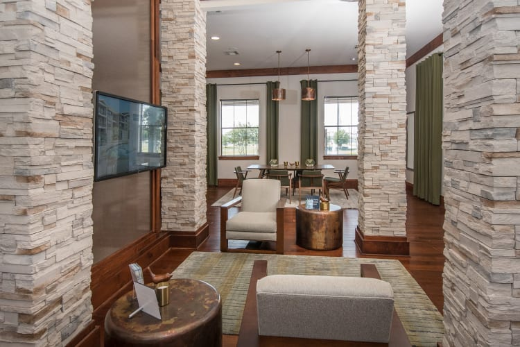 Resident clubhouse with bar seating at Villas Tech Ridge in Pflugerville, Texas