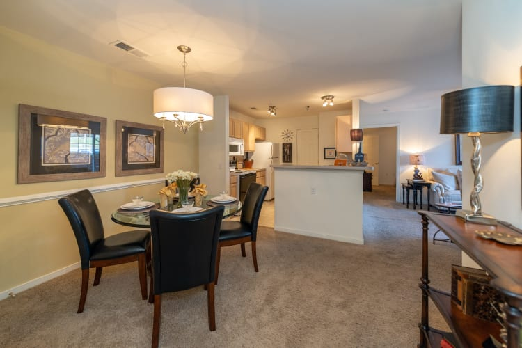 Well-decorated living area in an open-concept model home at The Overlook at Stonemill in Lynchburg, Virginia