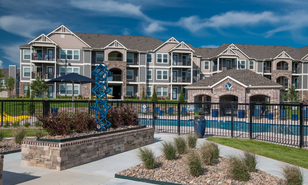 Outdoor pool and lounge area at Cottages at Crestview in Wichita, Kansas