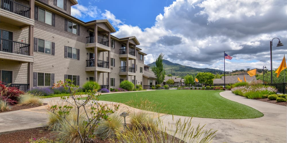 Large grassy area with walking paths at The Springs at Veranda Parkin Medford, Oregon
