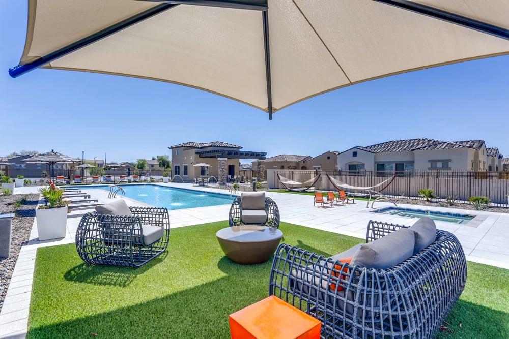 Pool and common area with shade at Avilla Camelback Ranch in Phoenix AZ