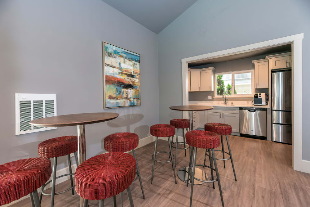 Clubhouse lounge with bar seating at Tower Apartment Homes in Alameda, California