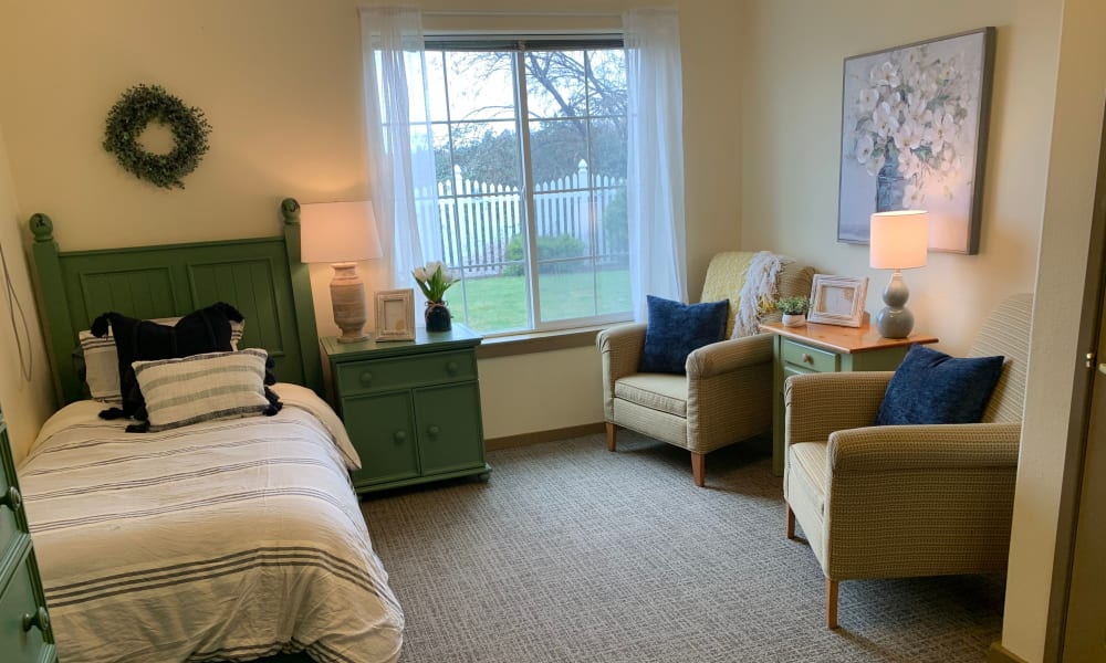 Bed and seating in bedroom at Generations at Lewiston in Lewiston, Idaho