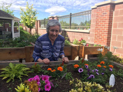 Happy senior woman enjoying activities of memory care at at Eastern Star Masonic Retirement Campus in Denver, CO