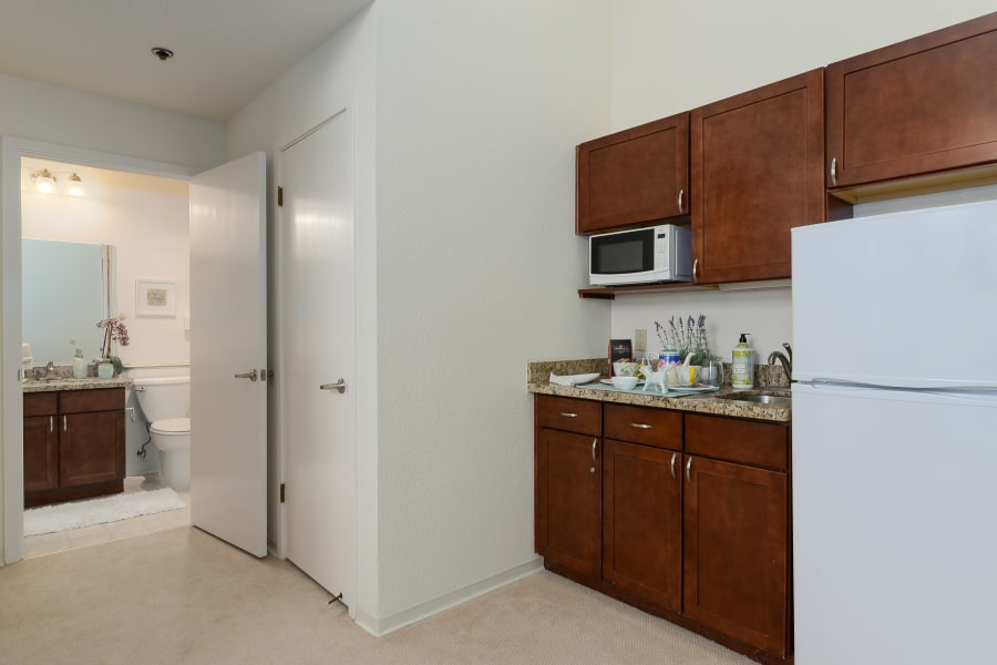 Kitchen and bathroom in suite at Palo Alto Commons in Palo Alto, California