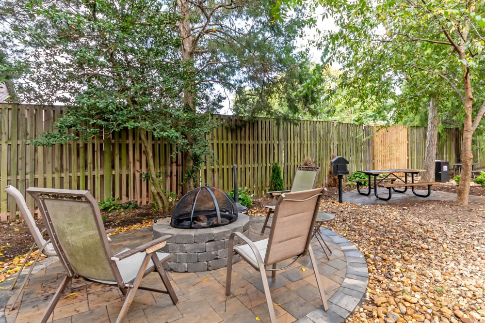An outdoor patio with a firepit at Manassas Station Apartments in Manassas, Virginia