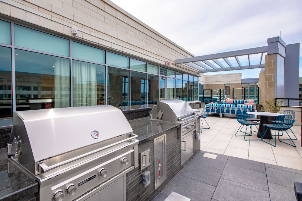 Roof-top barbecues with tables and chairs at Harlow in Washington, District of Columbia