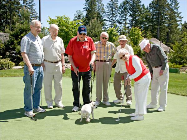 Residents golfing at Patriots Landing in DuPont, Washington.