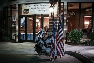 Motorcycle with American flag on the back