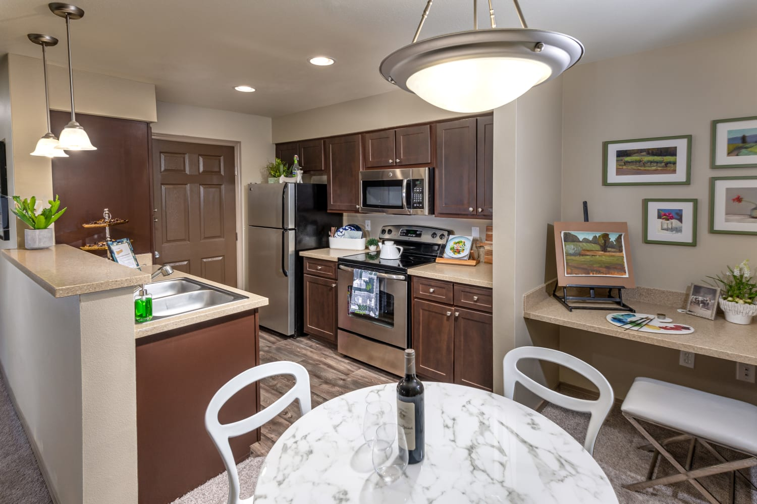Model kitchen and dining room at The Knolls at Inglewood Hill in Sammamish, Washington