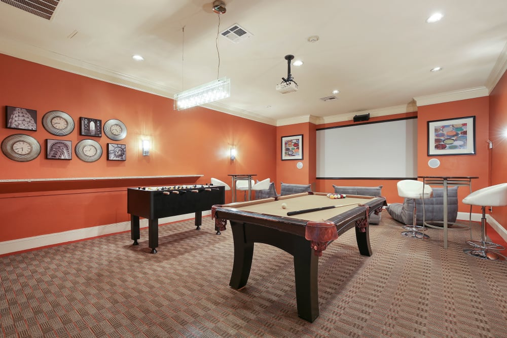 Community game room with a billiards table at The Lyndon in Irving, Texas