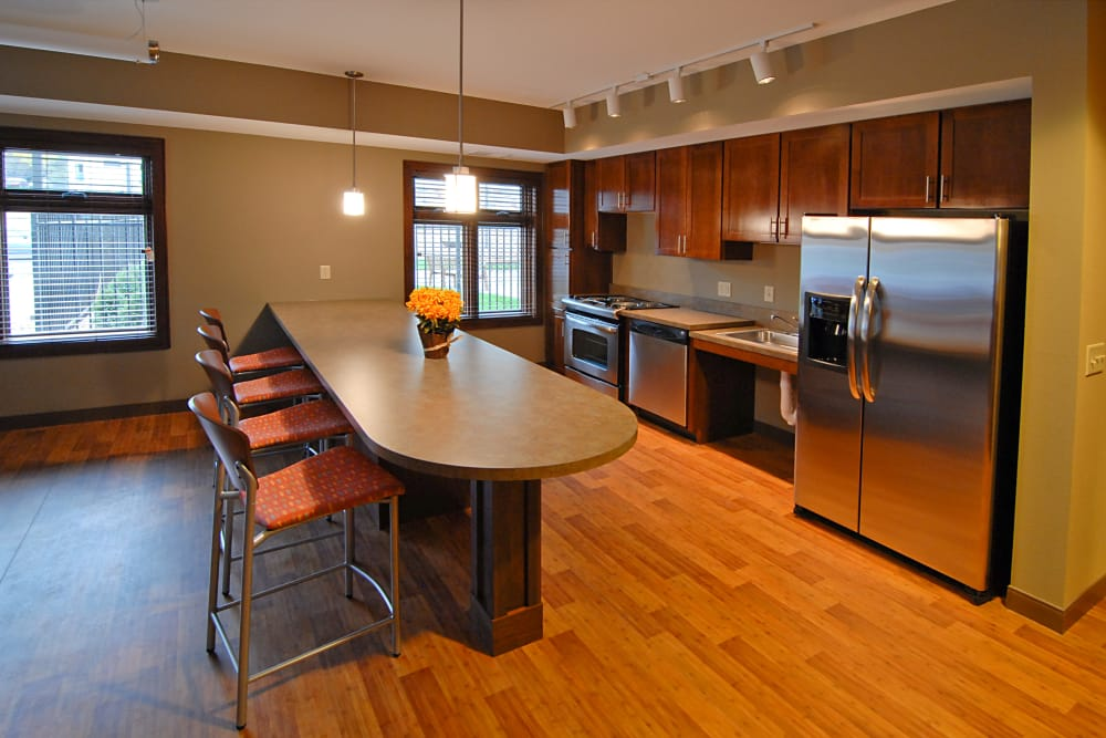 A kitchen with stainless steel appliances at The Glenn Minnetonka
