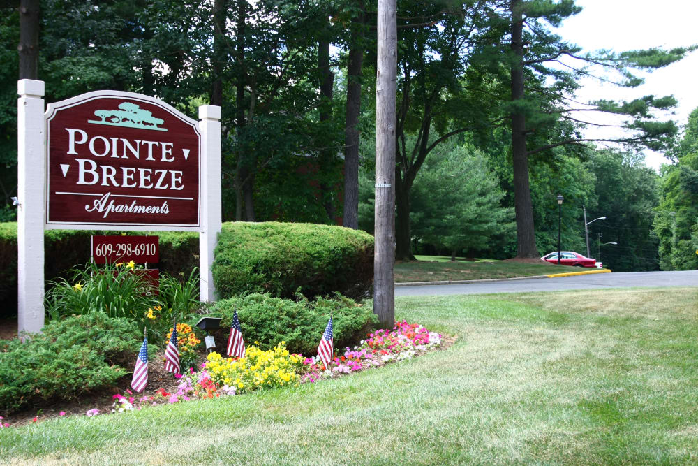 Sign welcoming residents and guests at Pointe Breeze Apartments