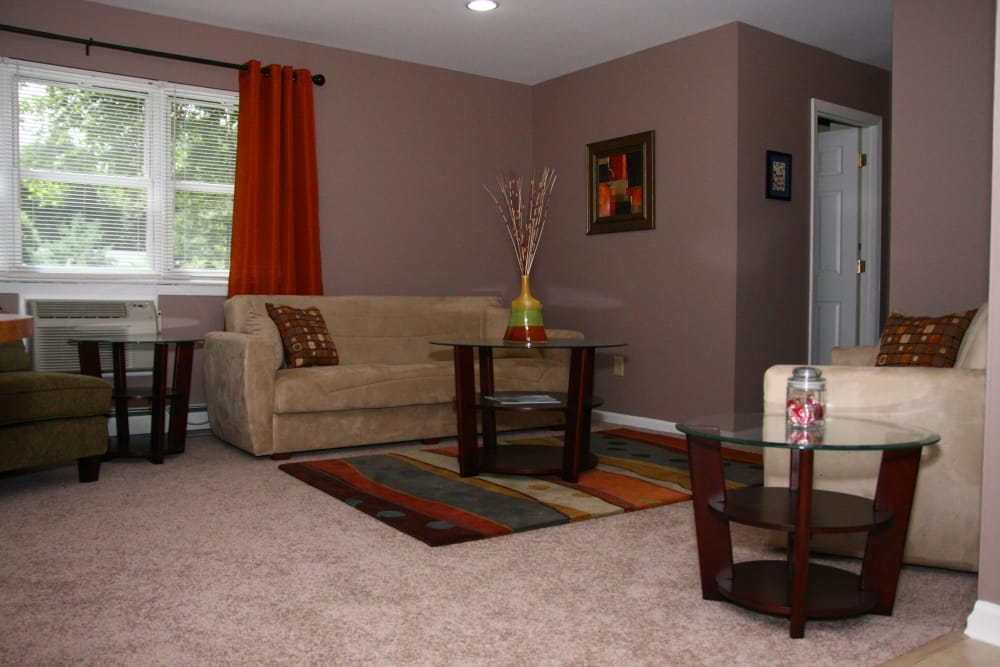 Spacious living room at Pointe Breeze Apartments in Bordentown, New Jersey
