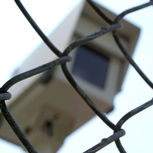 Security camera behind barbed wire fence at Red Dot Storage in Chillicothe, Ohio