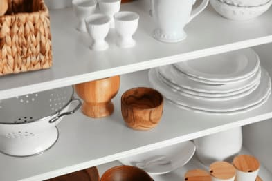 Kitchen shelve with dishes and wood cups
