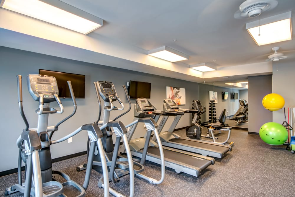 A spacious community gym at Manassas Station Apartments in Manassas, Virginia