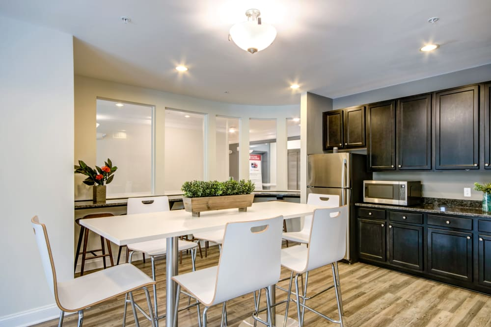 A community  kitchen with a fridge at Manassas Station Apartments in Manassas, Virginia