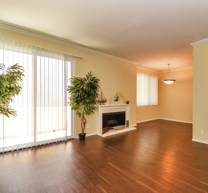 Living room with fireplace and hardwood floors at IMT Beverly Arnaz in Los Angeles, CA