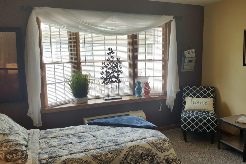 Bedroom area at Brookstone Estates of Harrisburg in Harrisburg, Illinois.
