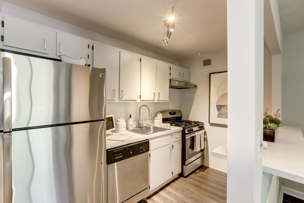 A kitchen with stainless-steel appliances at The Landings I & II Apartments in Alexandria, Virginia
