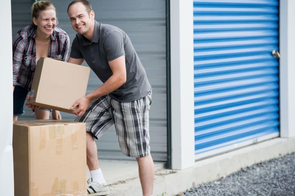 Customers loading a storage unit at Mini Storage Depot in Concord, North Carolina