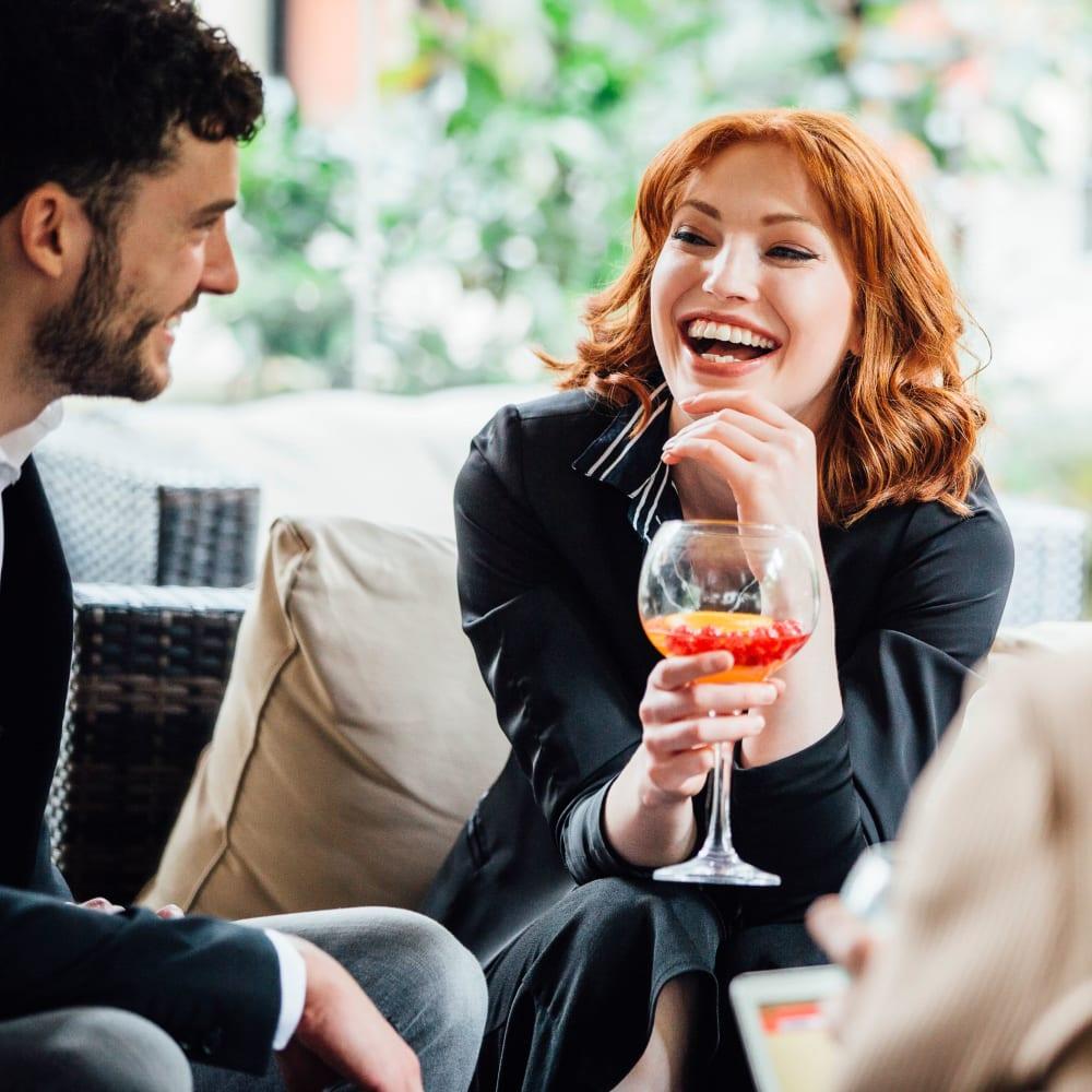 Friends having drinks at Ingleside Apartments in North Charleston, South Carolina
