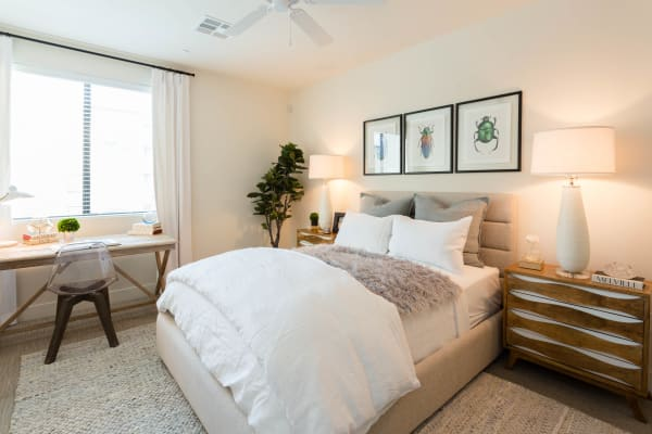 Well-decorated bedroom in model home at Avant at Fashion Center in Chandler, Arizona