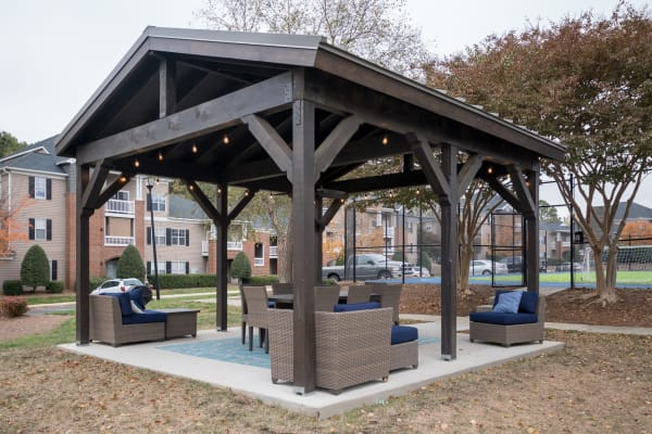 Outdoor, covered community seating area at Palmetto Place in Fort Mill, South Carolina