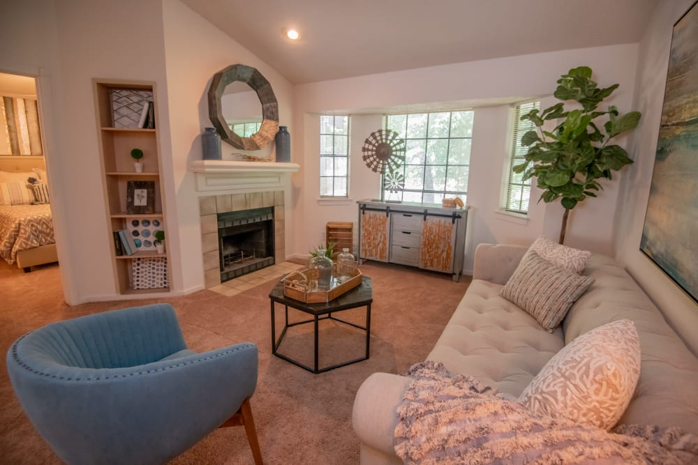 Carpeted living room with a fireplace at The Trace of Ridgeland in Ridgeland, Mississippi