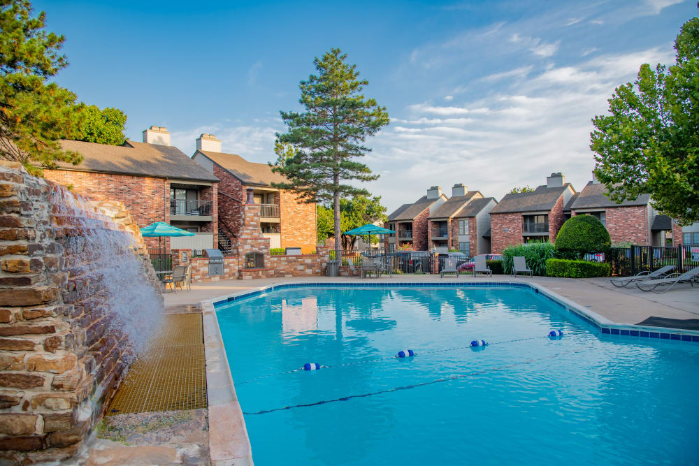 Relaxing pool and waterfall at Warrington Apartments  in Oklahoma City, Oklahoma