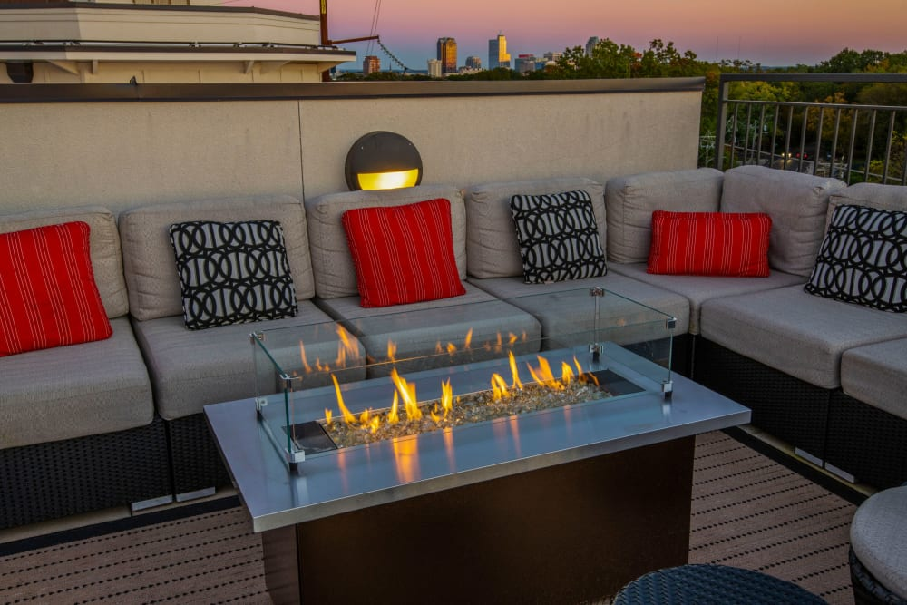 Rooftop terrace with fire table at sunset at 401 Oberlin in Raleigh, North Carolina