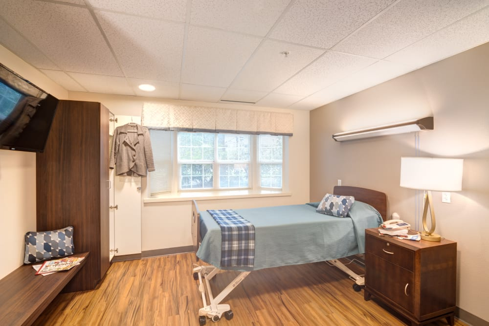 A resident suite with hardwood floors at Mission Healthcare at Bellevue in Bellevue, Washington.