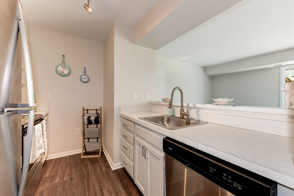 A kitchen with plenty of counter space at The Landings I & II Apartments in Alexandria, Virginia