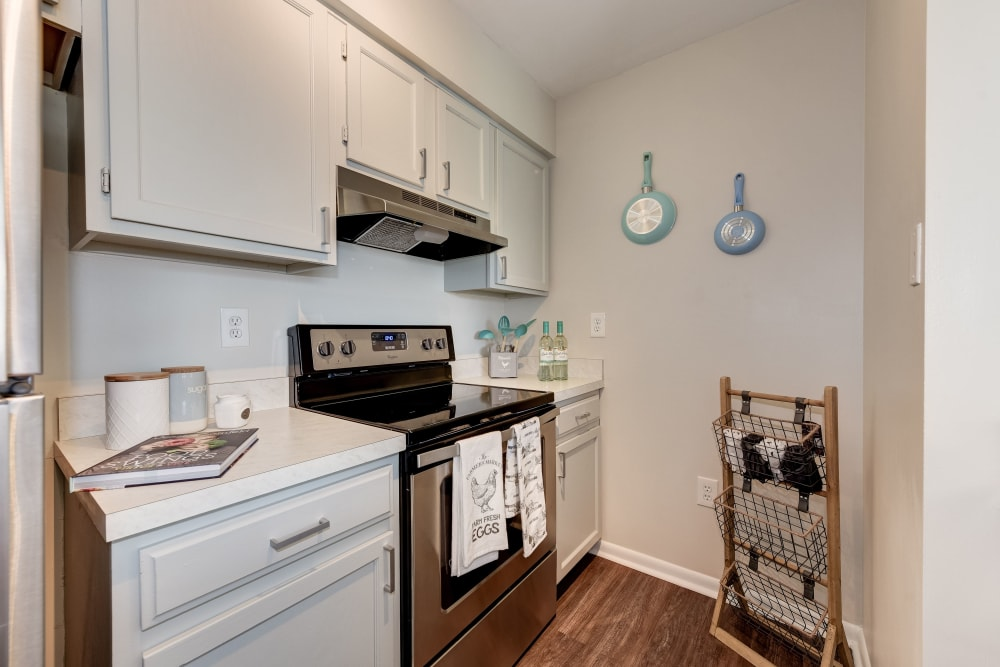 A kitchen with white cabinet space at The Landings I & II Apartments in Alexandria, Virginia