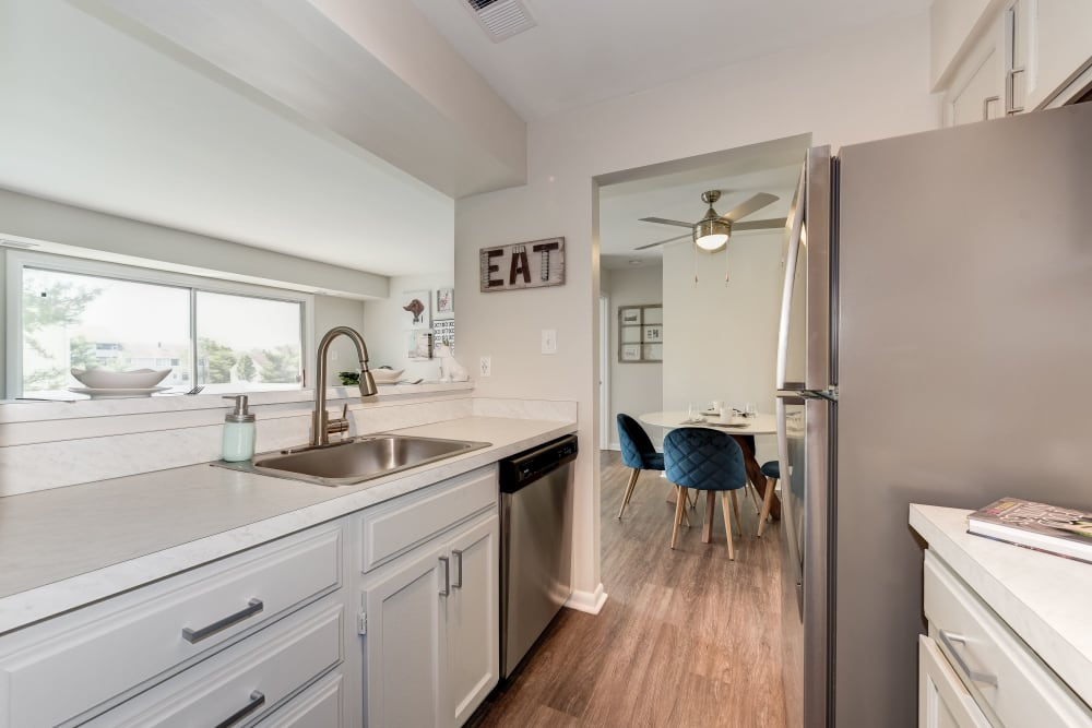 A kitchen with a pass-through window at The Landings I & II Apartments in Alexandria, Virginia