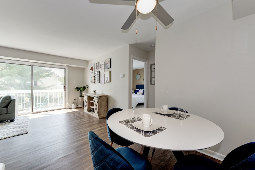 A dining room with wood-style flooring at The Landings I & II Apartments in Alexandria, Virginia
