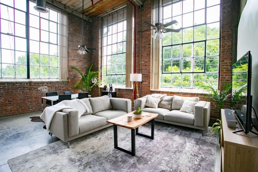 Model living room at Newnan Lofts Apartment Homes in Newnan, Georgia