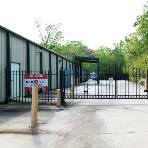 Entrance gate to outdoor units at Red Dot Storage in Madisonville, Louisiana