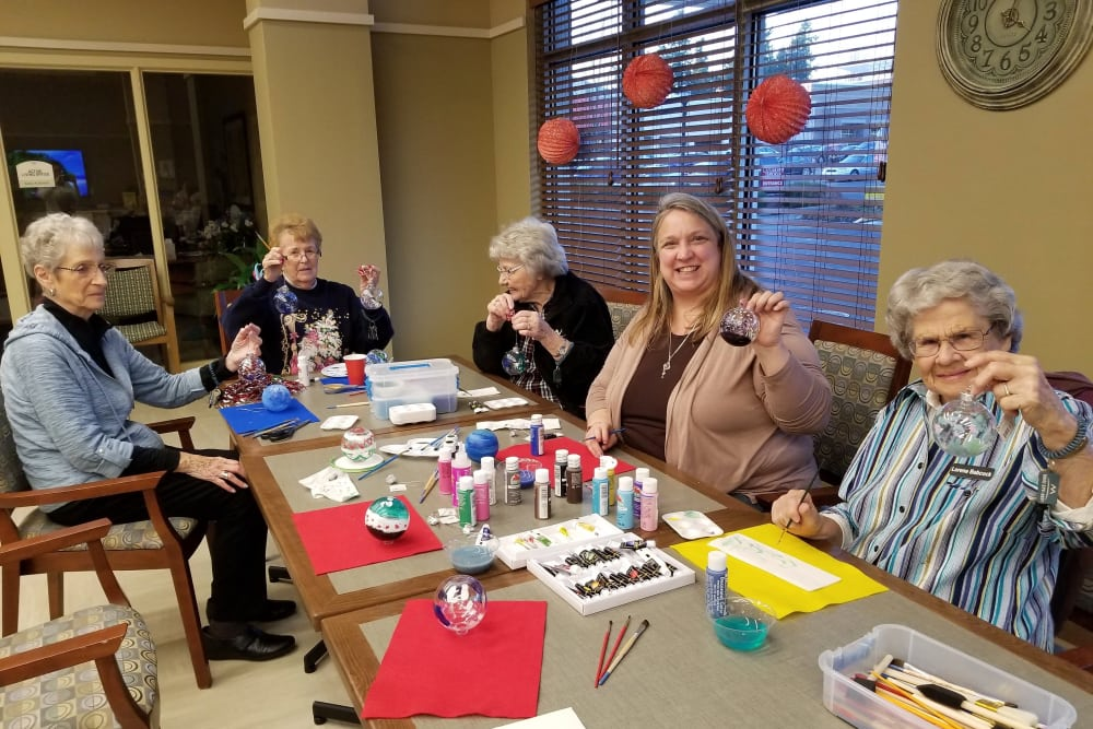 Residents crafting at Merrill Gardens at Burien in Burien, Washington.