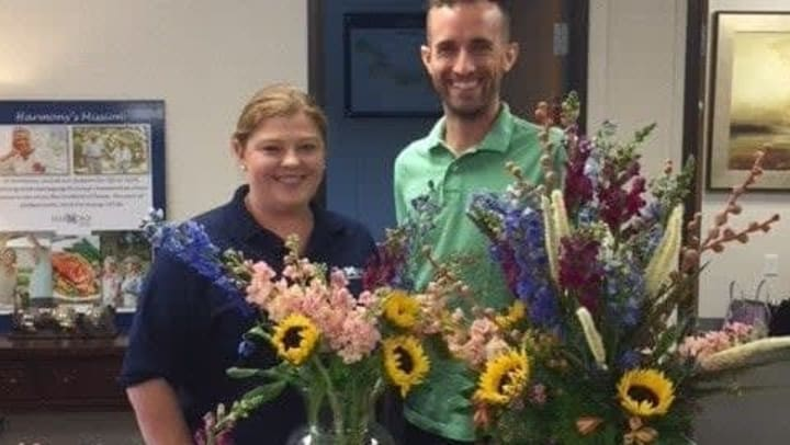 Aaron Sears from Plantology Emporium bringing flowers to Harmony