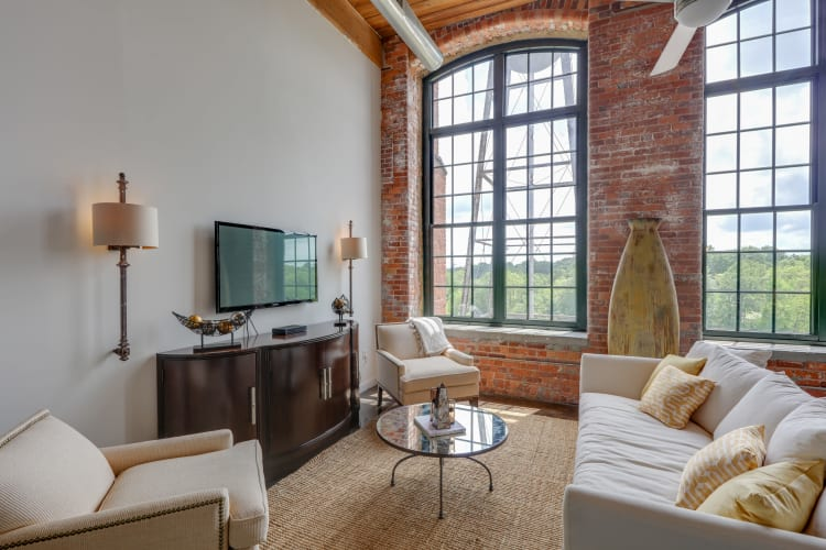Spacious living room at The Lofts Of Greenville in Greenville, South Carolina