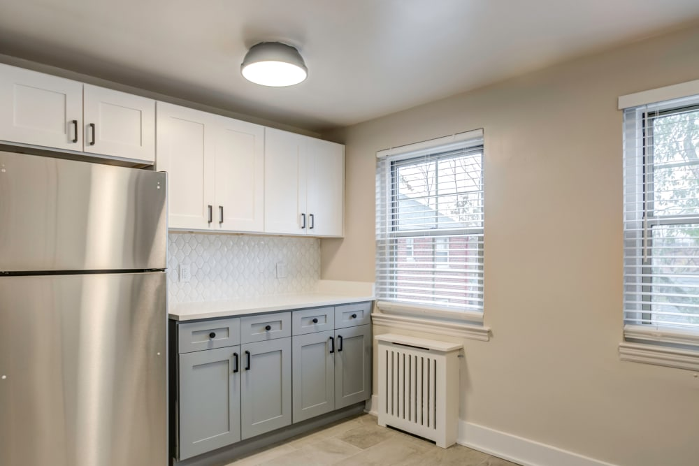 Kitchen with a stainless-steel fridge at Haven New Providence in New Providence, New Jersey