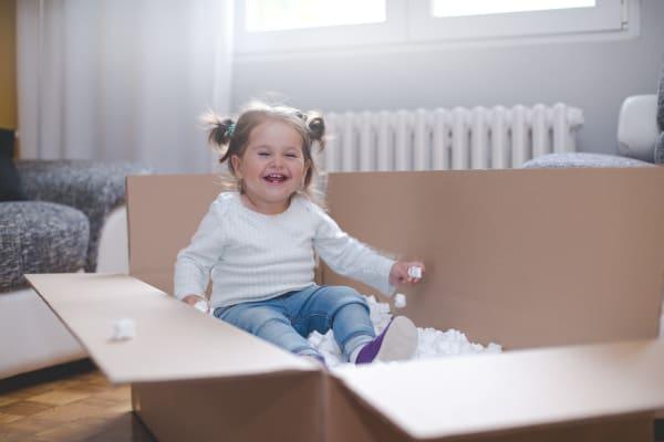 A child plaing in a box near Trojan Storage in Vancouver, WA