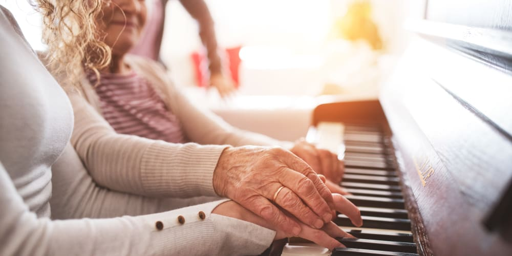 A resident and family member enjoying the Music Speaks Program at Arlington Place of Grundy Center in Grundy Center, Iowa.